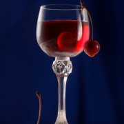 Glass with cherries and cherry liqueur